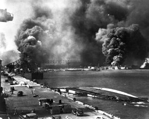 Pearl Harbor viewed from Pier 1010, 7 Dec 1941 after the attack (US National Archives)