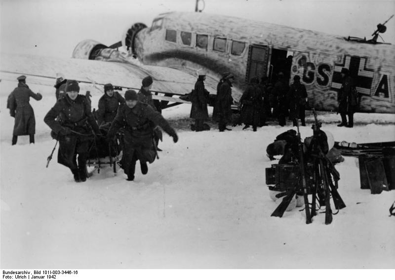 German troops in the Demyansk Pocket unloading supplies from a Ju 52 transport, Jan 1942 (German Federal Archive: Bild 101I-003-3446-16)