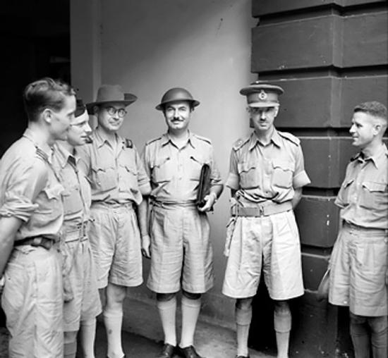 Lt. Gen. Arthur Percival meeting with war correspondents, Singapore, circa late Jan 1942 (Imperial War Museum)