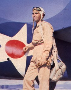 "Lt. Edward ""Butch"" O'Hare in front of a Grumman F4F-3 Wildcat fighter, spring 1942 (US Navy photo)"