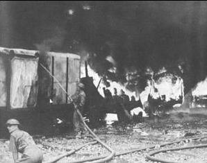 Firefighters at work after Japanese air raid on Singapore, 8 February 1942 (public domain via Wikipedia)