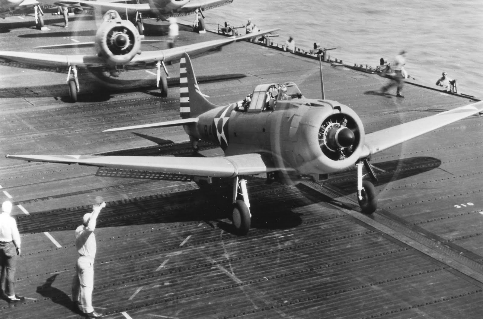 SBD-3 Dauntless dive-bombers prepare for launch from carrier USS Enterprise, early 1942 (US National Archives)