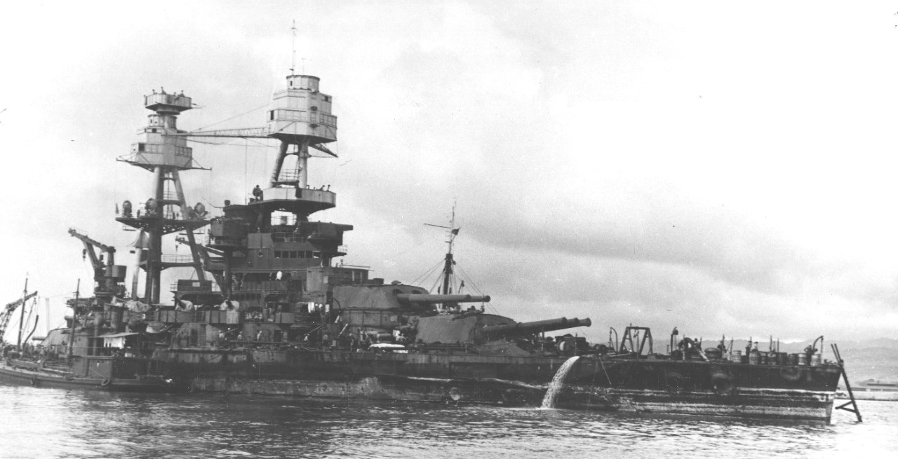 Battleship USS Nevada refloated after being sunk on 7 Dec 1941 and ready to be moved to dry dock, Pearl Harbor, Hawaii, 17 Feb 1942 (US Navy photo)