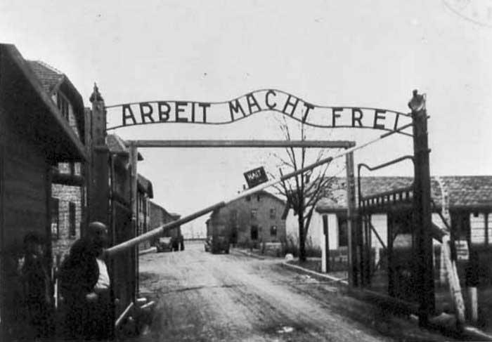 Gates at Auschwitz concentration camp, 1945 (public domain via WW2 Database)