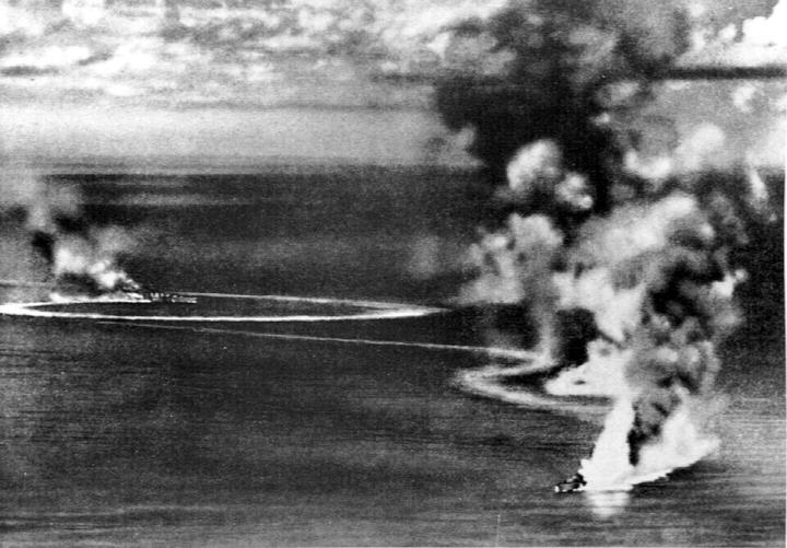 British cruisers Dorsetshire and Cornwall burning during the raid on Ceylon, 5 Apr 1942; photo taken from Japanese aircraft (public domain via WW2 Database)