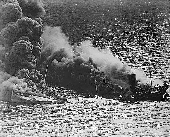 US tanker Dixie Arrow sinking after being torpedoed by German submarine U-71, off North Carolina, 26 Mar 1942 (US National Archives)