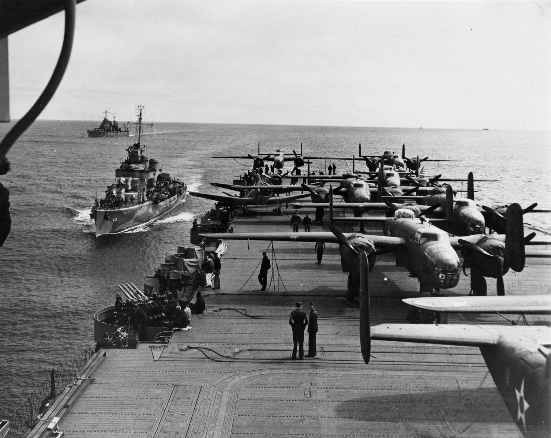 Aft flight deck of carrier USS Hornet en route to the Doolittle Raid, April 1942; destroyer USS Gwin and cruiser USS Nashville in background (US Naval History & Heritage Command)