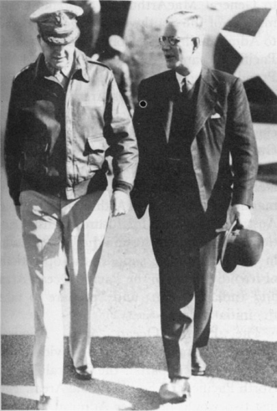 Australian Prime Minister John Curtin greeting Douglas MacArthur as the US general arrives in Sydney, Australia by air, 1940s (US Army Center for Military History)