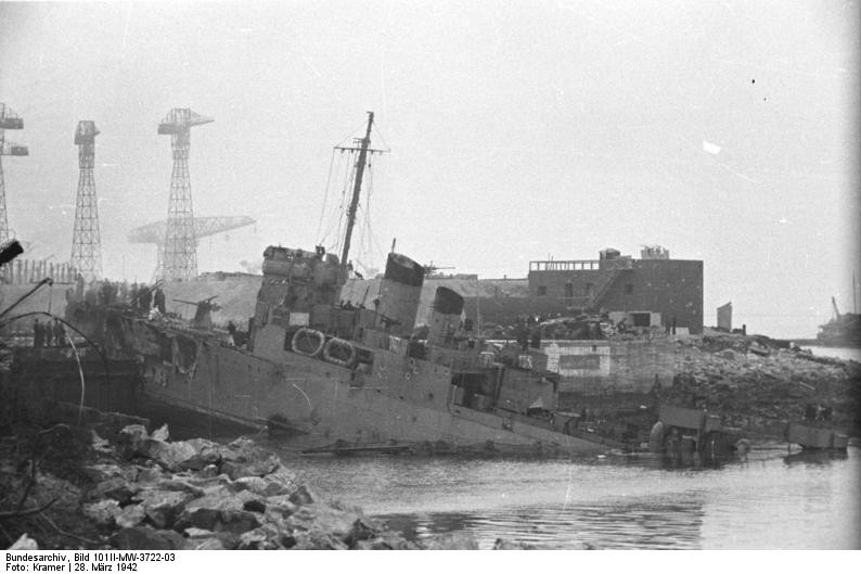 HMS Campbeltown wedged in the dock gates of Saint-Nazaire, France, 28 Mar 1942 (German Federal Archive: Bild 101II-MW-3722-03)