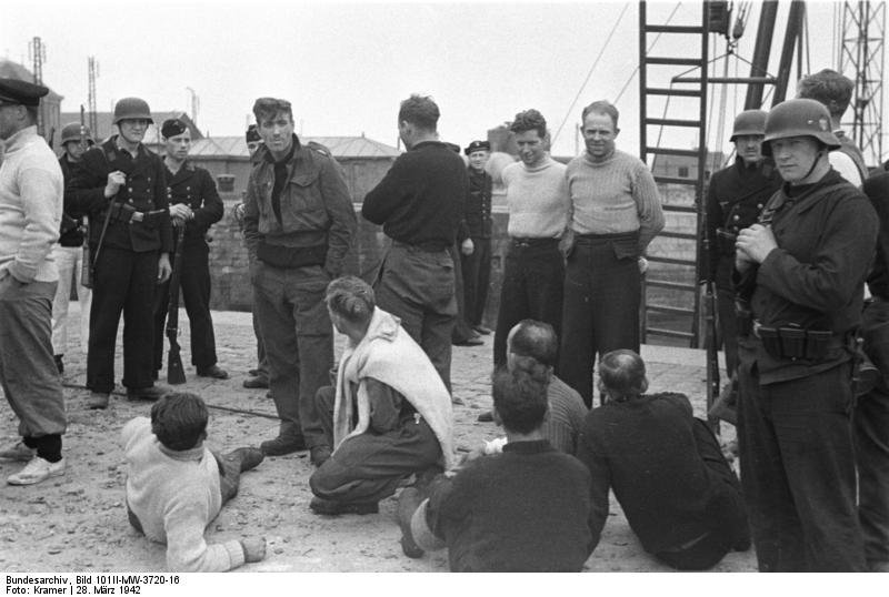 Germans guarding British prisoners of war, Saint-Nazaire, France, 28 Mar 1942 (German Federal Archive: Bild 101II-MW-3720-16)