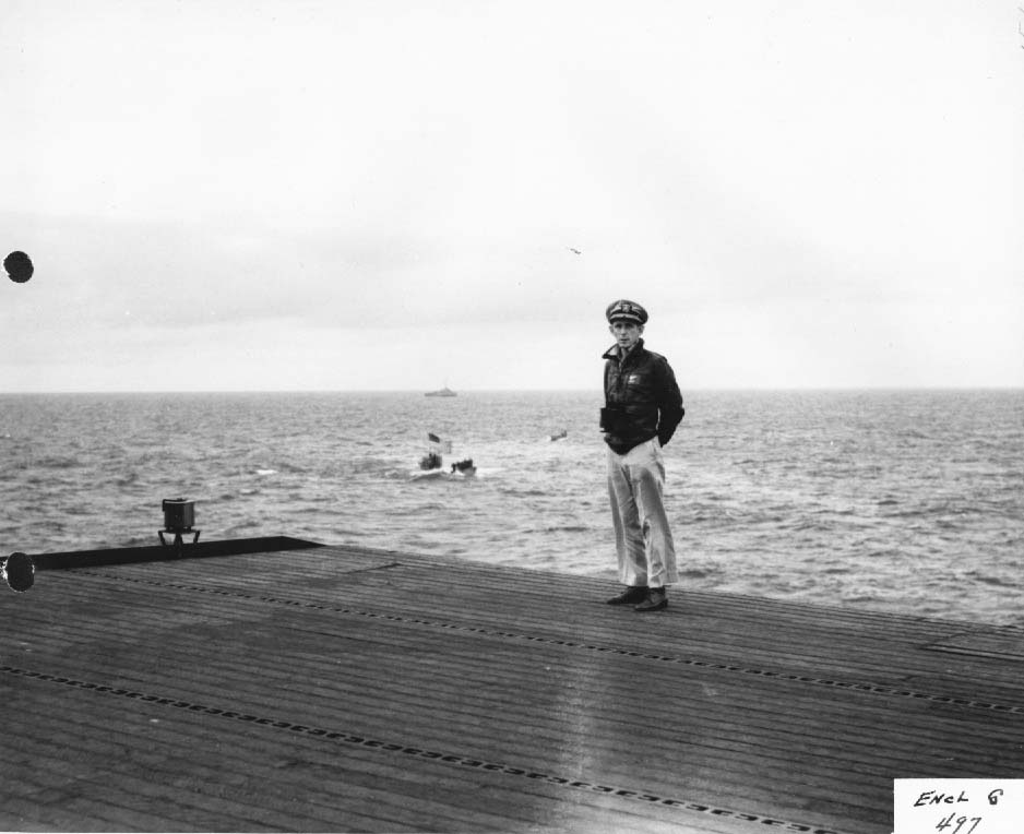 Capt. Daniel Gallery on flight deck of USS Guadalcanal with captured German U-boat U-505 in tow, June 1944 (US National Archives)