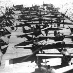 RAF Spitfires being hauled aboard carrier USS Wasp, Glasgow, Scotland, 13 Apr 1942 (public domain via WW2 Database)