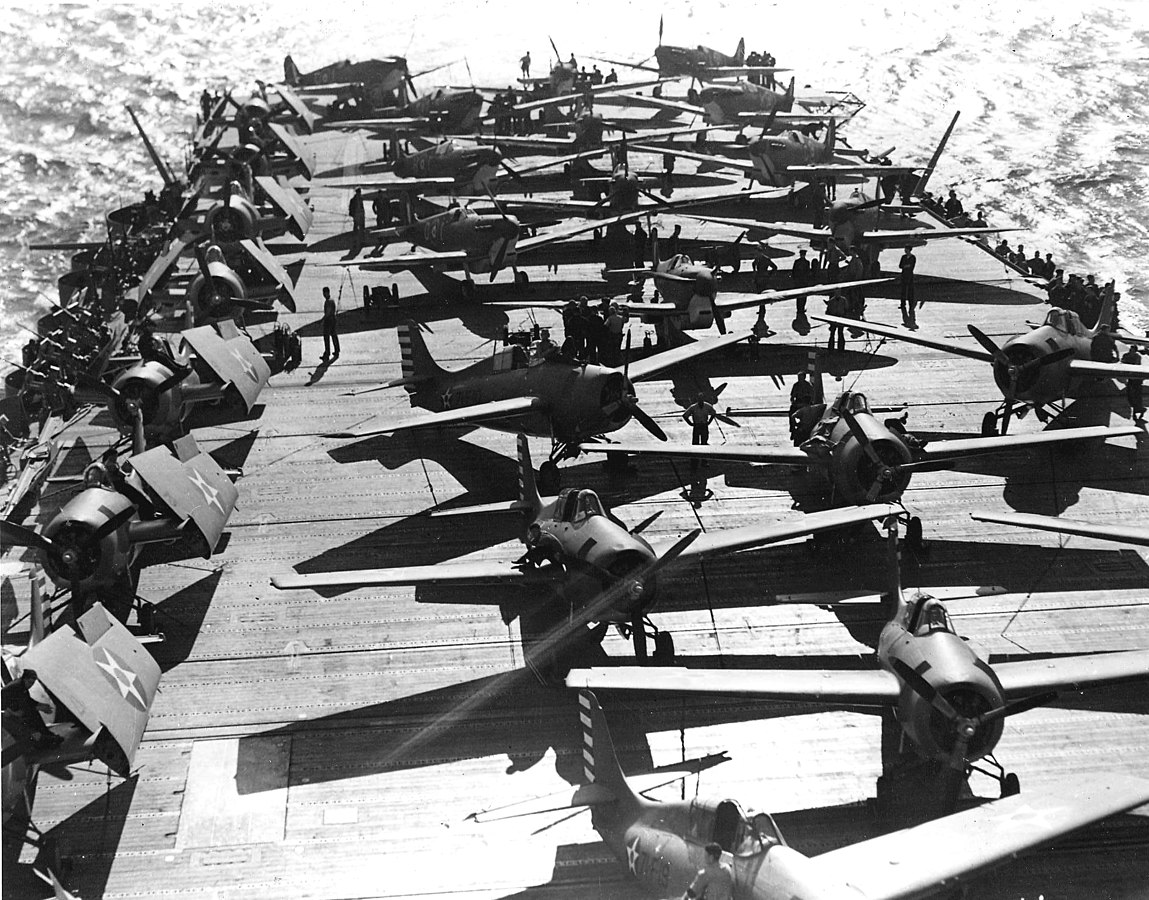 RAF Spitfires being hauled aboard carrier USS Wasp, Glasgow, Scotland, 13 Apr 1942 (public domain via WW2 Database)