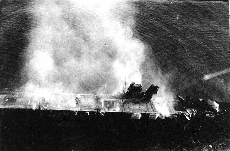 Japanese carrier Hiryu burning, photographed by a plane from Japanese carrier Hosho, 5 Jun 1942 (US Naval History and Heritage Command)