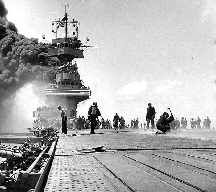 Carrier USS Yorktown burning after hit by three Japanese bombs, 4 Jun 1942 (US National Archives)