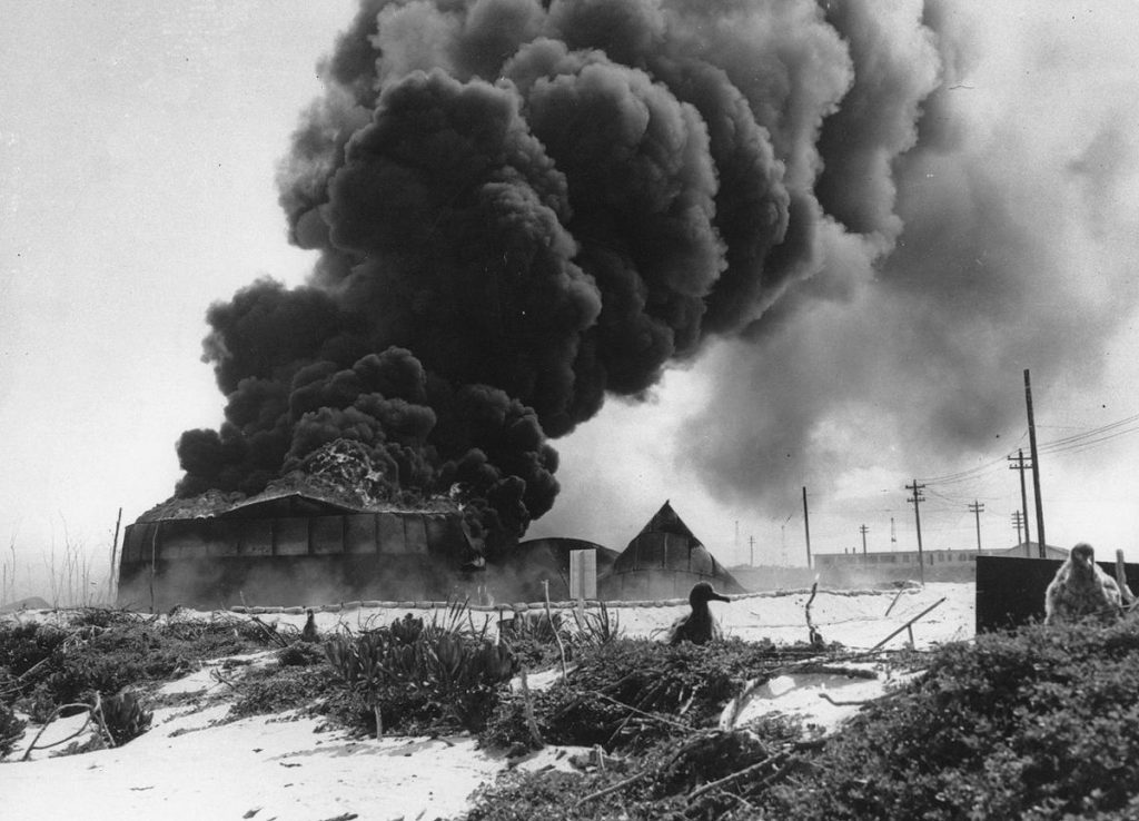Oil tanks burning on Midway Atoll after Japanese attack, 4 Jun 1942 (US National Archives)