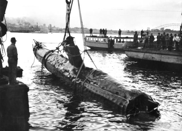 Japanese midget submarine raised from Sydney Harbor, Australia, the day after the attack, 1 Jun 1942 (Australian War Memorial)
