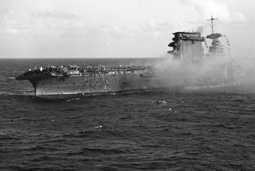 USS Lexington's crewmen abandoning ship and boarding a destroyer, 8 May 1942 (US National Museum of Naval Aviation)