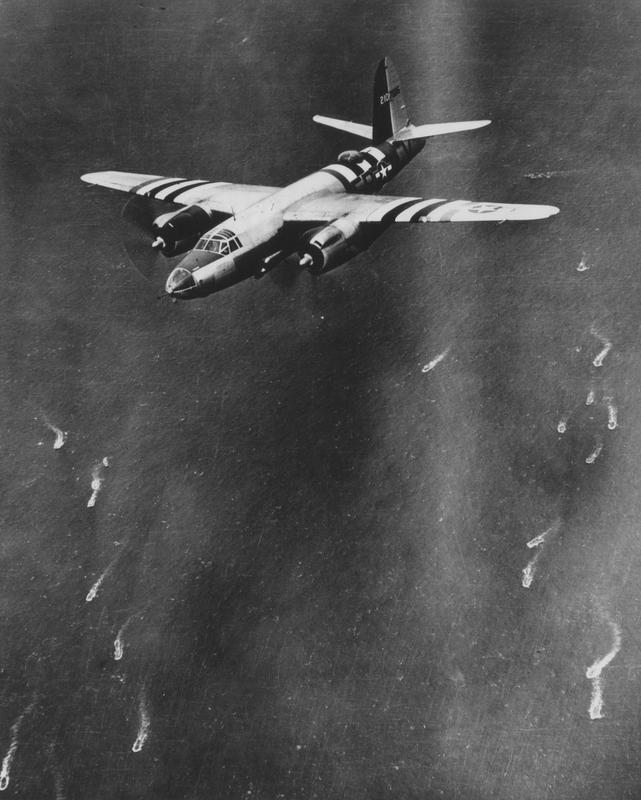 A B-26 Marauder of the 322nd Bomb Group in flight over ships heading for Normandy on D-Day, 6 June 1944. (Imperial War Museum, Roger Freeman Collection)