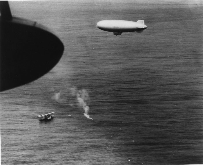 US Coast Guard PH-2 seaplane lands to rescue survivors from U-701 - Navy K-type airship overhead had located survivors and dropped raft and supplies. An Army A-29 had sunk U-701 on 7 July 1942 off Wilmington, NC. This rescue took place on 9 July 1942. (US Navy photo)