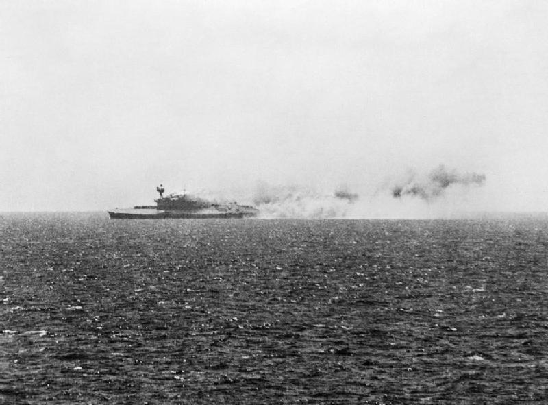 HMS Eagle listing in the Mediterranean Sea, 11 Aug 1942 (Imperial War Museum)