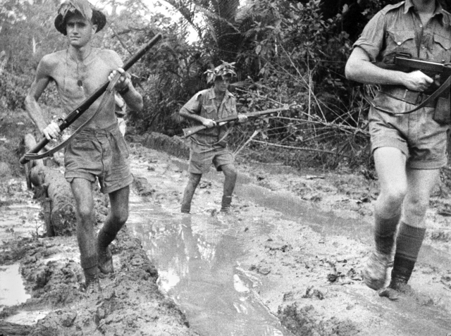 Australian troops at Milne Bay, New Guinea, shortly after the unsuccessful Japanese invasion attempt, 1 Oct 1942 (Australian War Memorial)