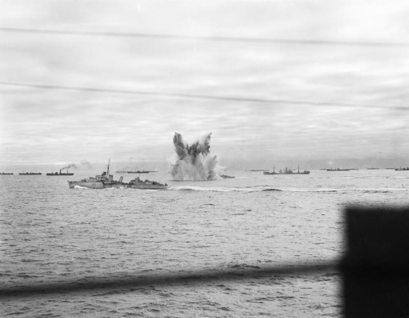 German bomb exploding near HMS Ashanti, HMS Wheatland, and HMS Eskimo, escorting Allied convoy PQ-18, Sep 1942 (Imperial War Museum)