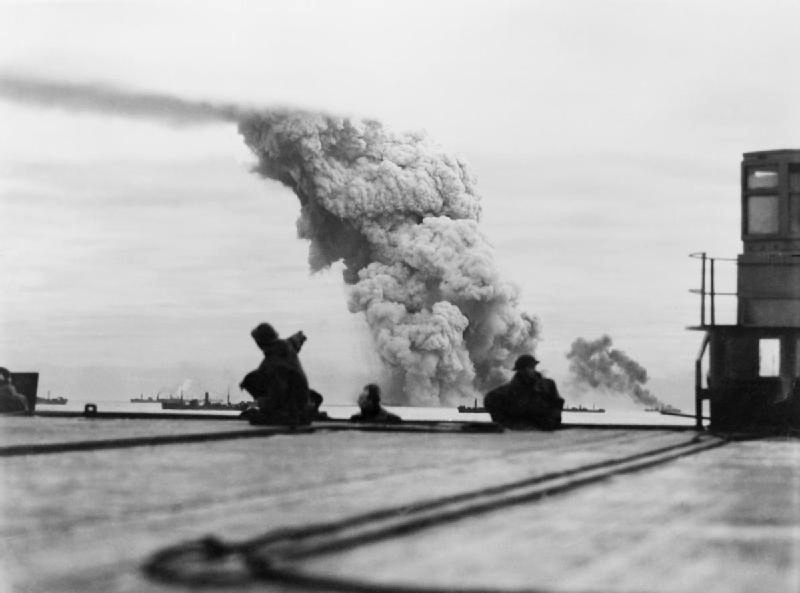Smoke rising from ammunition ship Mary Luckenbach in Allied convoy PQ-18, 13 Sep 1942; seen from escort carrier HMS Avenger (Imperial War Museum)