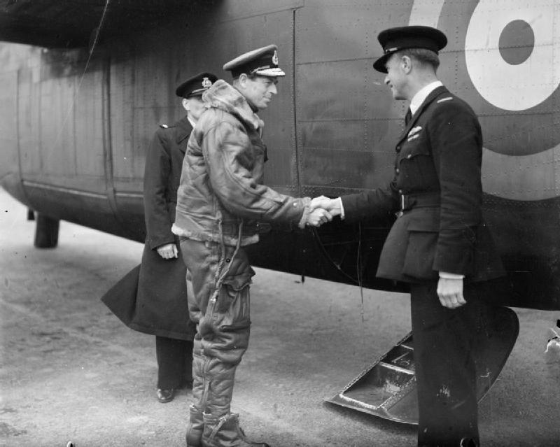 The Duke of Kent shakes hands with a BOAC pilot as he boards a Liberator of Ferry Command, Prestwick, Scotland, 1941-43. (Imperial War Museum)