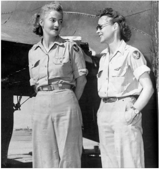 """Nancy Love (left) and Betty Gillies in 1943, the first women to fly the B-17 Flying Fortress heavy bomber; the two WAFS were set to ferry a B-17 to England when their flight was cancelled by General """"Hap"""" Arnold (US Air Force photo)"""