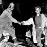 Cpl. Refines Sims Jr., left, and Pvt. Alfred Jalufkamet of the US Army Corps of Engineers meeting in the middle after completing construction of the Alcan Highway, 1942. (US Army Corps of Engineers photo)