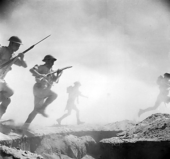 Australian soldiers running toward the front lines during reenactment of Second Battle of El Alamein, 24 Oct 1942 (Imperial War Museum)