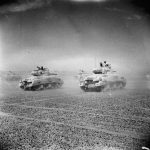Sherman tanks of the Eighth Army speed across the desert as Axis forces retreat from El Alamein, November 1942 (Imperial War Museum)