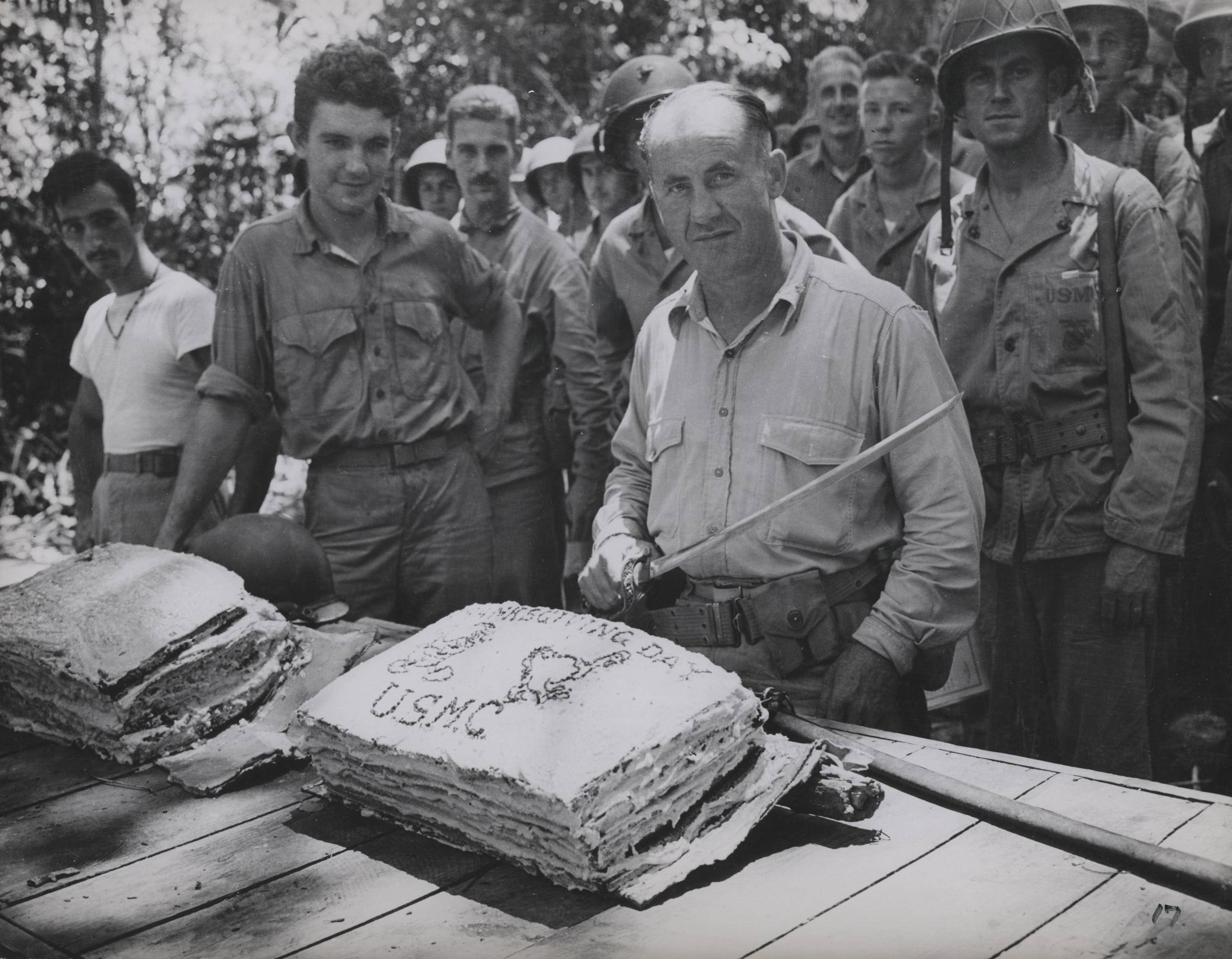 USMC Lt. Col. W.W. Stickney preparing to cut a Thanksgiving cake with a captured Japanese sword, Guadalcanal, 26 Nov 1942 (US Marine Corps photo)