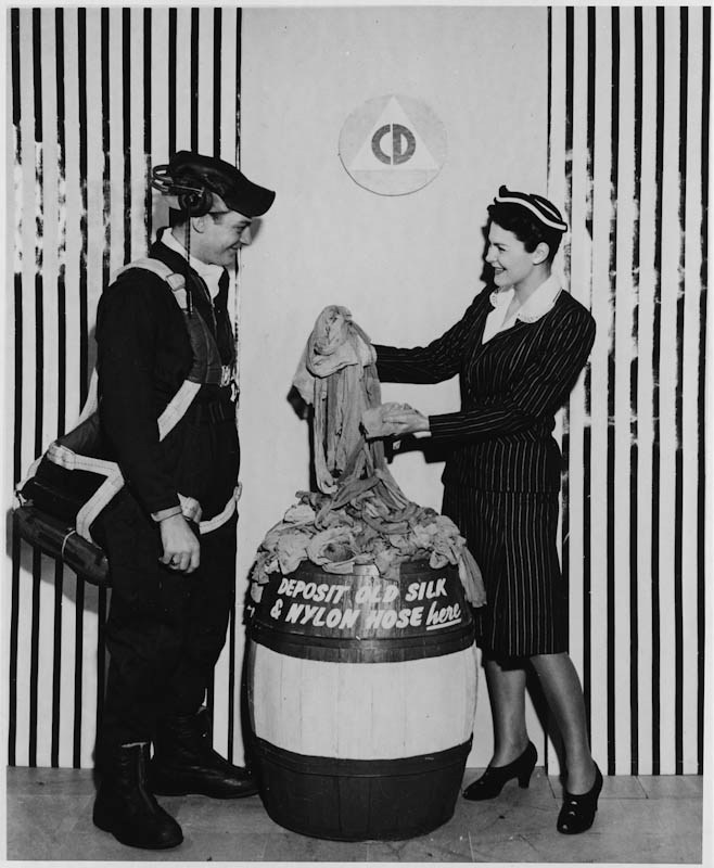 Deena Clark, Civilian Defense (right), and Tech. Sgt. Leo Malkins of the Army Air Forces (left) collecting used stockings, 1942 (Library of Congress: LC-DIG-fsa-8b08080)
