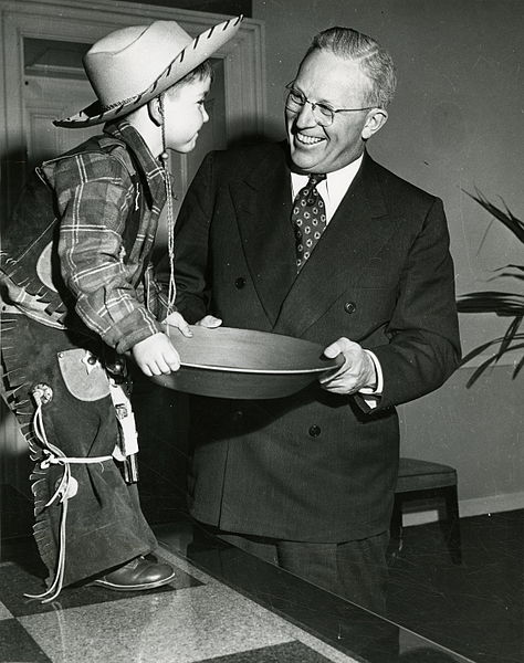California Governor Earl Warren with a small boy dressed as a prospector, during the California Centennial Celebration, 1948-50 (California State Archives)