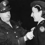Brig. Gen. Fred Borum presents the Air Medal to Lt. Elsie Ott, the first woman to receive the Air Medal. (US Air Force photo)