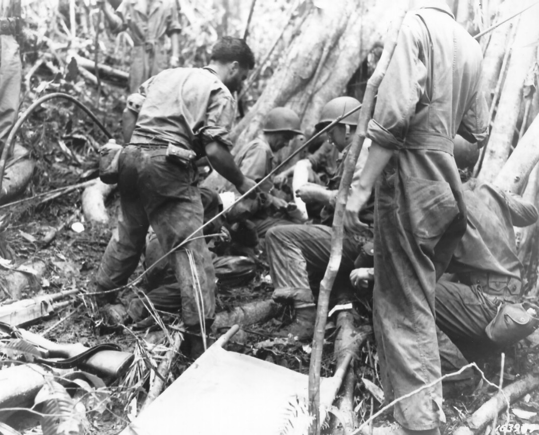 Medical Battalion of US 25th Division giving first aid, Guadalcanal, 10 Jan 1943 (US Department of Defense photo)