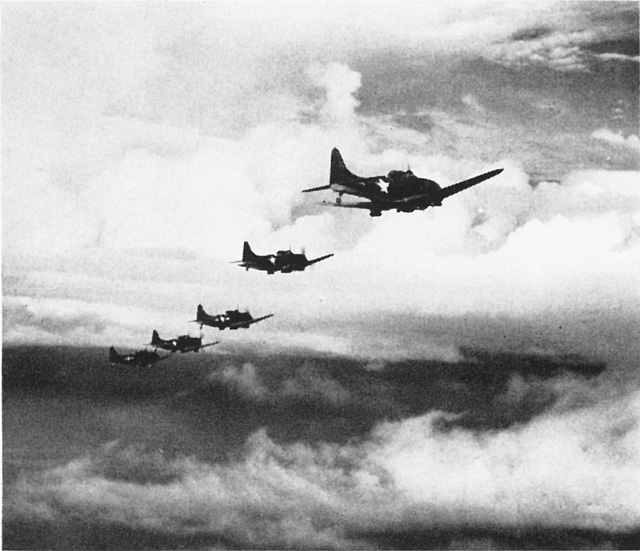 US Navy or USMC SBD Dauntless dive-bombers on mission in the Solomon Islands, early 1943 (US Navy photo)
