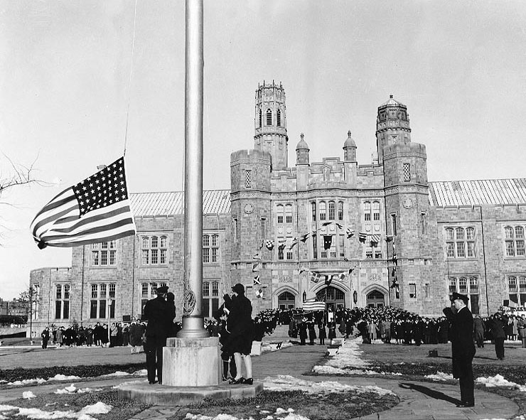 Raising the flag at US Naval Training Center, Hunter College, Bronx, NY, 8 Feb 1943 (US National Archives)