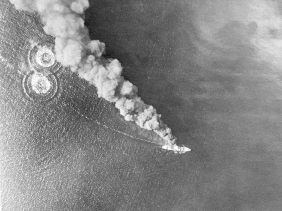 Bombing of a Japanese ship by a B-25 bomber of the US 3rd Bomb Group during the Battle of Bismarck Sea, 2-4 Mar 1943 (public domain via WW2 Database)