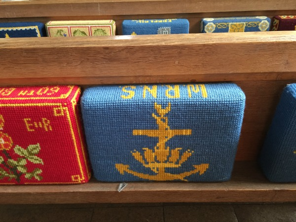 """WRNS"" (Wrens) needlepoint kneeling cushion in St. James Church, Southwick, Hampshire, England, September 2017 (Photo: Sarah Sundin)"