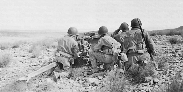 US 37-mm antitank gun crew waits for the German column through Faïd Pass, Tunisia, 14 February 1943 (US Army Center of Military History)