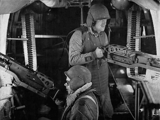 Waist gunners on a B-24 Liberator wearing protective flak vests and helmets (US National Archives)