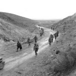 US troops marching through Kasserine Pass, Tunisia, 26 Feb 1943 (US Army Signal Corps photo)