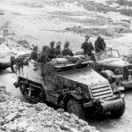 Field Marshal Erwin Rommel talking to German troops in captured American half-track, Tunisia, 1943 (German Federal Archives: Bild 146-1990-071-31)