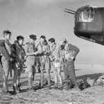Crew of an RAF Wellington at Kairouan Airfield, Tunisia, being briefed before a bombing raid to Sicily, 9 July 1943 (Imperial War Museum)