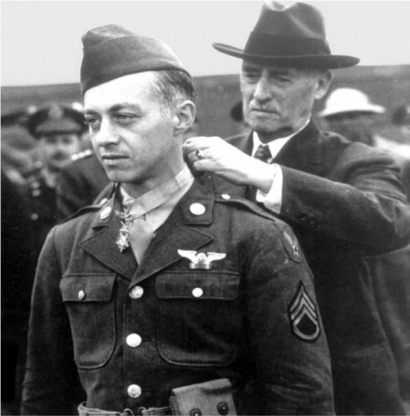 "Secretary of War Henry Stimson awarding the Medal of Honor to Staff Sgt. Maynard ""Snuffy"" Smith of 306th Bombardment Group, 12 July 1943 (US Army Air Force photo)"