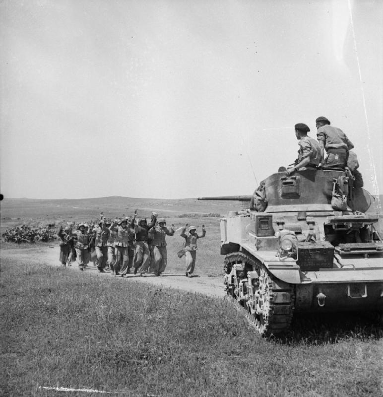 German troops surrender to the crew of a Stuart tank in Tunisia, 6 May 1943 (Imperial War Museum)