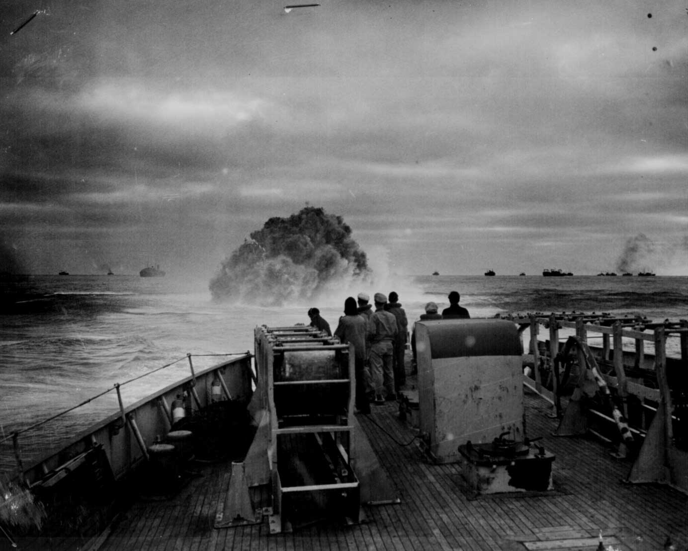 Crew of US Coast Guard Cutter Spencer watch as their depth charge explodes near German U-boat U-175, 17 April 1943 (US National Archives)